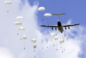 Russian soldiers make parachute jumps during a training session for the upcoming joint anti-terror military drill in Taonan